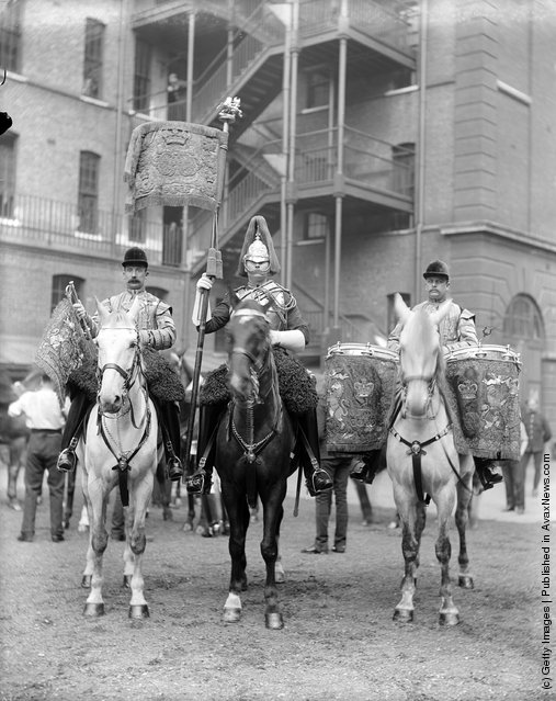 1898: A standard bearer, drummer and trumpeter of the Second Life Guards parading at the funeral of British prime minister William Gladstone
