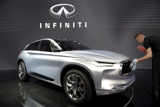A man brushes dust off the Infinity QX Sport Inspiration Concept after its world debut during the Auto China 2016 auto show in Beijing April 25, 2016. (Photo by Damir Sagolj/Reuters)