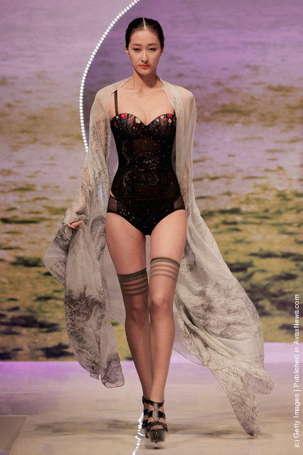 A model showcases designs on the catwalk during the Ordifen Cup China Lingerie Design Contest 2011 of China Fashion Week