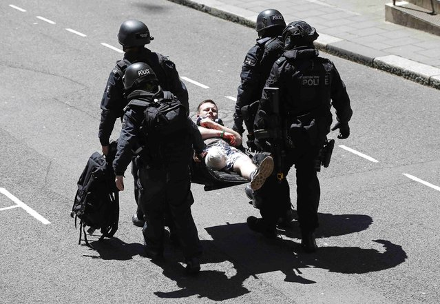London Metropolitan Police take part in Exercise Strong Tower, removing actors as casualties from the scene of a mock terror attack at a disused underground station in central London, Britain June 30, 2015. (Photo by Peter Nicholls/Reuters)