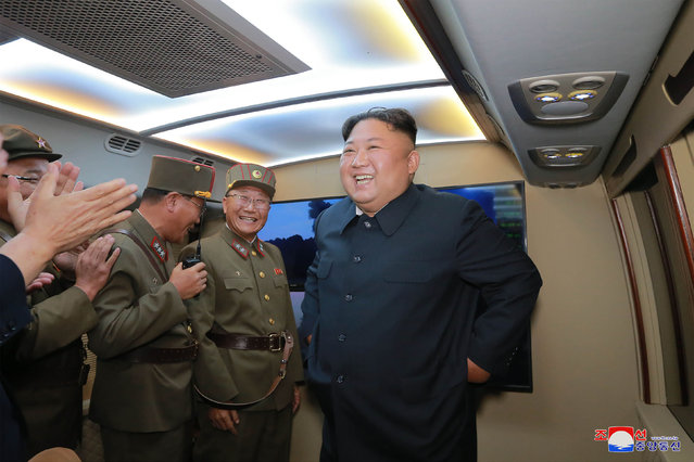 "In this Tuesday, August 6, 2019, file photo provided by the North Korean government, North Korean leader Kim Jong Un, right, visits an airfield in the western area of North Korea to watch its weapons demonstrations. North Korea on Friday, Aug. 9, 2019 said that its rubber-stamp parliament will hold its second meeting of the year on Aug. 29. It follows weeks of intensified North Korean weapons tests and belligerent statements over U.S.-South Korea military exercises and the slow pace of nuclear negotiations with the United States. Independent journalists were not given access to cover the event depicted in this image distributed by the North Korean government. The content of this image is as provided and cannot be independently verified. Korean language watermark on image as provided by source reads: ""KCNA"" which is the abbreviation for Korean Central News Agency. (Photo by Korean Central News Agency/Korea News Service via AP Photo/File)"
