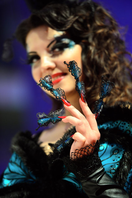 """A model shows off her nails, which was the work of a participant in the """"Haut Couture"""" contest of the OMC Hairworld World Cup on May 4, 2014 in Frankfurt am Main, Germany. (Photo by Thomas Lohnes/Getty Images)"""