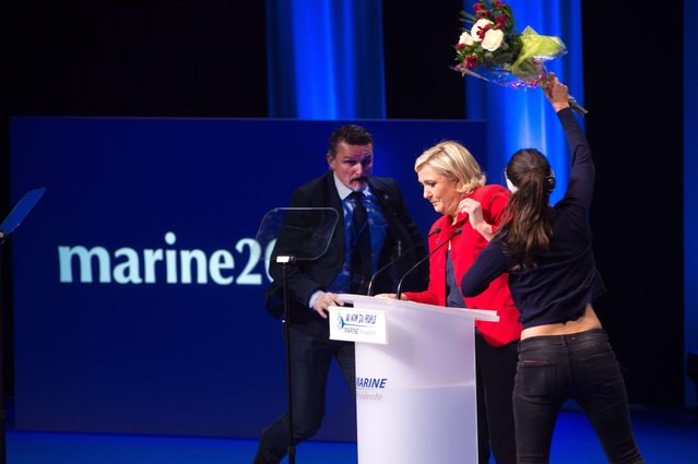A Femen attack Marine Le Pen as she delivers a speech during french presidential far-right candidate speech during a campaign rally at Zenith on April 17, 2017 in Paris, France. (Photo by Laurent Chamussy/SIPA Press/Rex Features/Shutterstock)