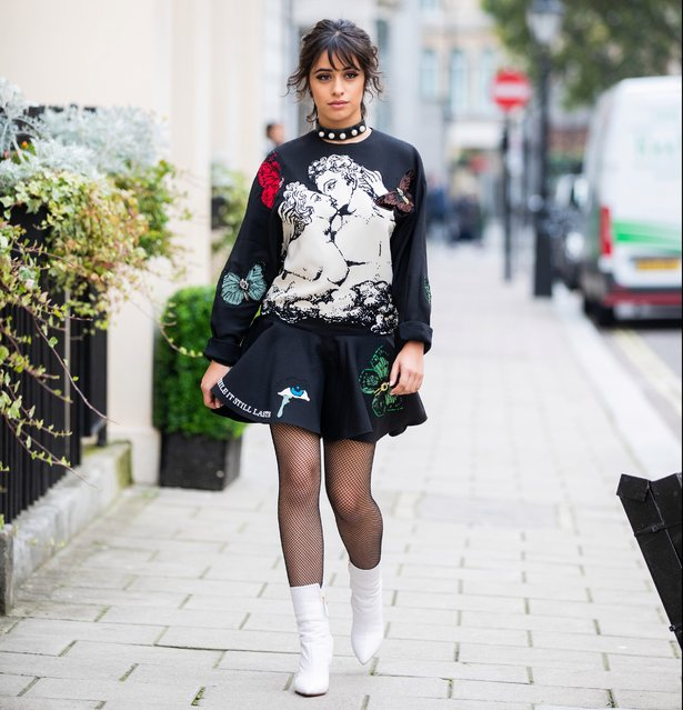 American-Cuban singer Camila Cabello is seen wearing total look Valentino bag, dress with graphic print, sheer tights, white ankle boots on October 03, 2019 in London, England. (Photo by Christian Vierig/GC Images)