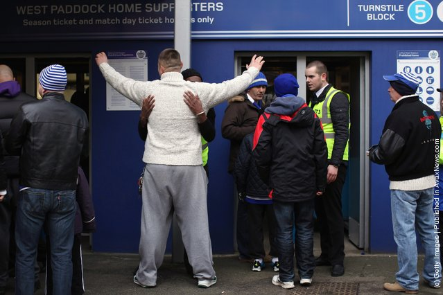 Football fans are searched before entering the Loftus Road stadium