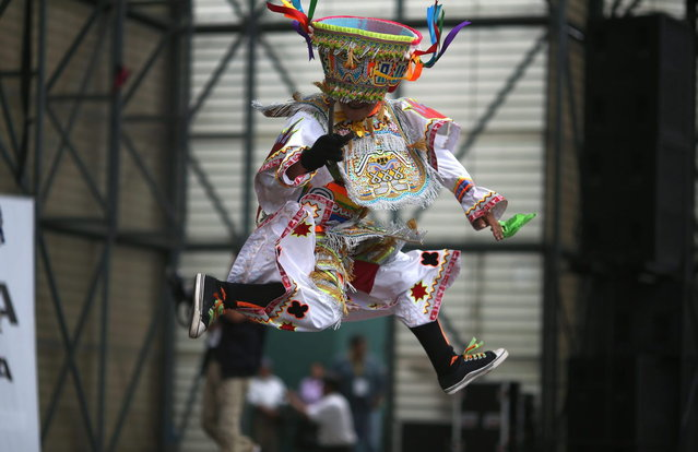 A scissors dancer performs during a dance competition in Lima, Peru, Sunday, May 18, 2014. The scissors dance is performed by inhabitants of Quechua villages and communities in the south-central Andes of Peru, and now in urban settings. This competitive ritual dance is performed during dry months coinciding with the main phases of the agricultural calendar. (Photo by Martin Mejia/AP Photo)