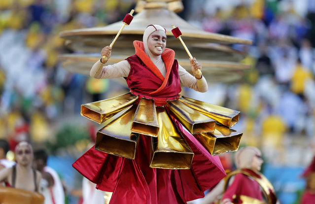 An actor performs during the opening ceremony of the 2014 World Cup at Itaquerao Stadium before the group A soccer match between Brazil and Croatia, the opening game in the tournament, in Sao Paulo, Brazil, Thursday, June 12, 2014. (Photo by Frank Augstein/AP Photo)