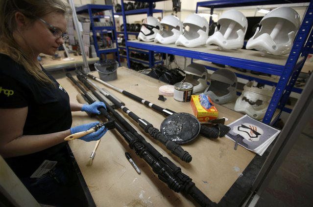 "A technician adds finishing touches to a replica replica of Rey's Staff from ""Star Wars: The Force Awakens"", in the Propshop headquarters at Pinewood Studios near London, Britain May 25, 2016. (Photo by Peter Nicholls/Reuters)"
