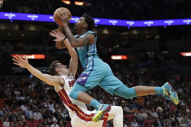 Charlotte Hornets guard Malik Monk, right, is fouled by Miami Heat forward Duncan Robinson during the first half of an NBA basketball game, Monday, November 25, 2019, in Miami. (Photo by Lynne Sladky/AP Photo)