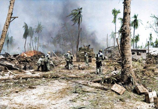 Soldiers make their way across the barren landscape in Kwajalein, Marshall Islands, 1944. (Photo by Royston Leonard/Mediadrumworld)