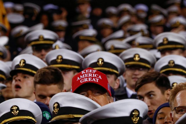 U.S. President Donald Trump greets U.S. Naval Academy Midshipmen during the annual Army-Navy collegiate football game at Lincoln Financial Field in Philadelphia, PA, U.S., December 14, 2019. (Photo by Tom Brenner/Reuters)