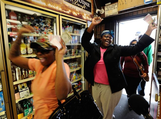 Sierra Luchien and Tammy Redlen are jubilant as they walk into the Blue Bird liquor store after waiting in line for nearly three hours to purchase their Mega Millions lottery ticket on March 29, 2012, in Hawthorne, Calif. There were three winning tickets sold for the record $656 million jackpot, but none were in California