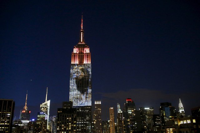 An image of Cecil the lion is projected onto the Empire State Building as part of an endangered species projection to raise awareness, in New York August 1, 2015. (Photo by Eduardo Munoz/Reuters)
