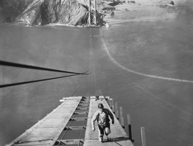 A worker running up one of the catwalks being built for the construction of the cable of the Golden Gate Bridge, San Francisco, California, September 19, 1935. (Photo by Underwood Archives/Getty Images)