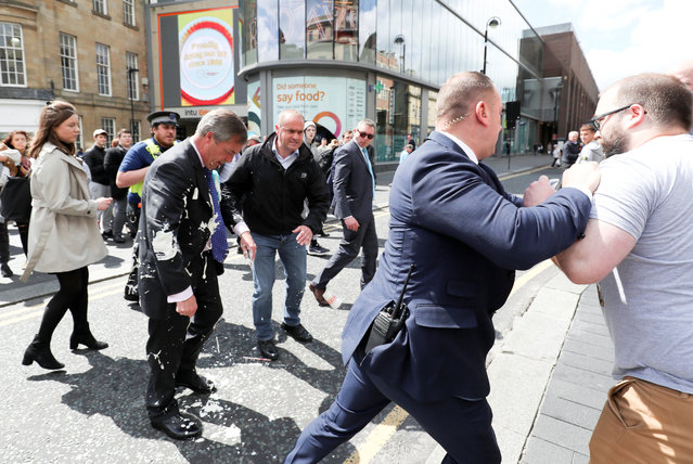Brexit Party leader Nigel gestures after being hit with a milkshake while arriving for a Brexit Party campaign event in Newcastle, Britain, May 20, 2019. (Photo by Scott Heppell/Reuters)