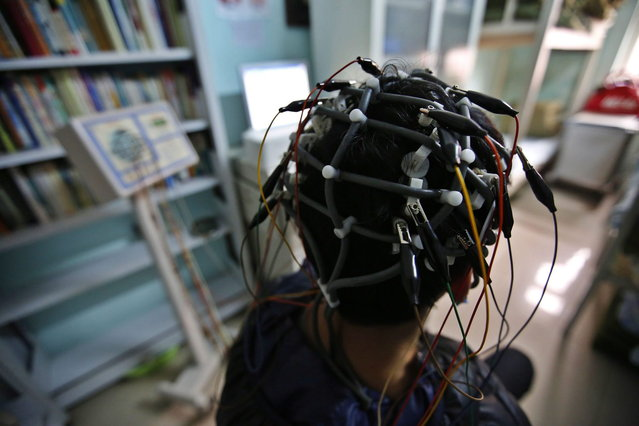 A boy who was addicted to the internet, has his brain scanned for research purposes at Daxing Internet Addiction Treatment Center in Beijing February 22, 2014.  (Photo by Kim Kyung-Hoon/Reuters)