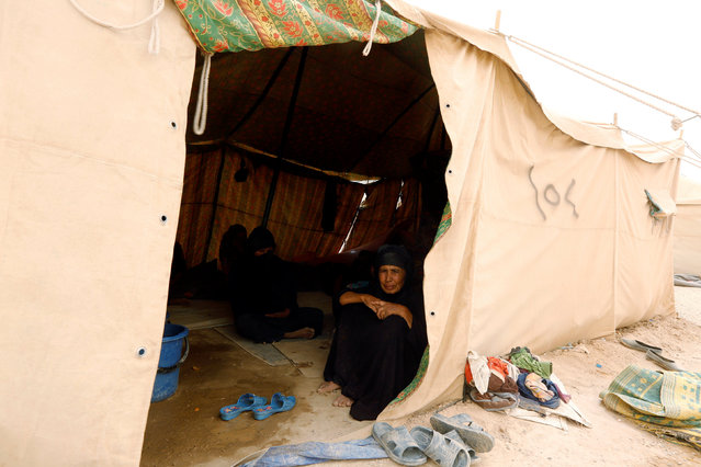An elderly woman, who fled from Falluja because of Islamic State violence, sits inside a tent at a refugee camp in Ameriyat Falluja, south of Falluja, Iraq,  June 16, 2016. (Photo by Ahmed Saad/Reuters)