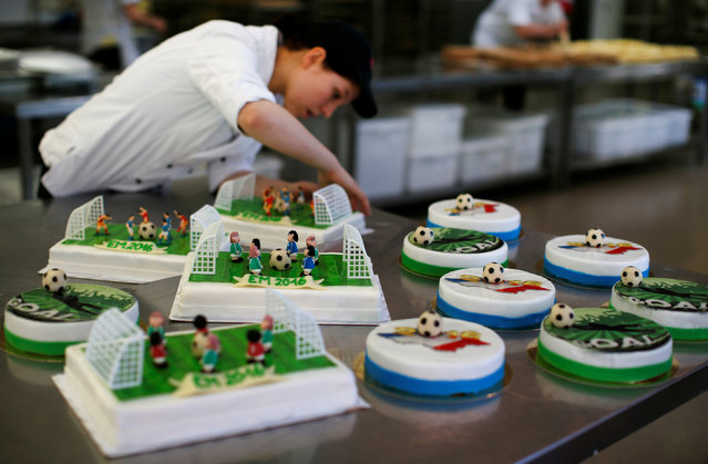 "A confectioner prepares soccer-themed cakes produced to celebrate the European Championship, in the confectionery ""Muenchner Freiheit"" in Munich, Germany June 20, 2016. (Photo by Michaela Rehle/Reuters)"