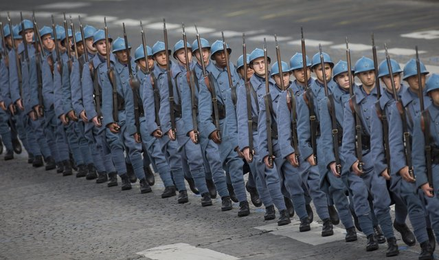 """Soldiers wearing French WWI uniforms, known as """"Poilus"""", march in traditional the military parade as part of the Bastille Day celebrations in Paris, France, 14 July 2014. (Photo by Ian Langsdon/EPA)"""