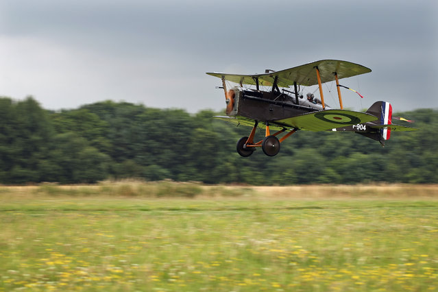 """Shuttleworth Collection Pilot Rodger """"Dodge"""" Bailey, takes off in the SE5a for demonstration flight at """"The Shuttlesworth Collection"""" at Old Warden on July 21, 2014 in Biggleswade, England. Of the 55,000 planes that were manufactured by the Royal Army Corps (RAC) during WWI, only around 20 remain in airworthy condition. (Photo by Dan Kitwood/Getty Images)"""