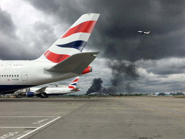 Smoke from a fire is seen at Heathrow Airport in London, Britain April 28, 2019 in this picture obtained from social media. (Photo by Jonathan Edgar/Reuters)