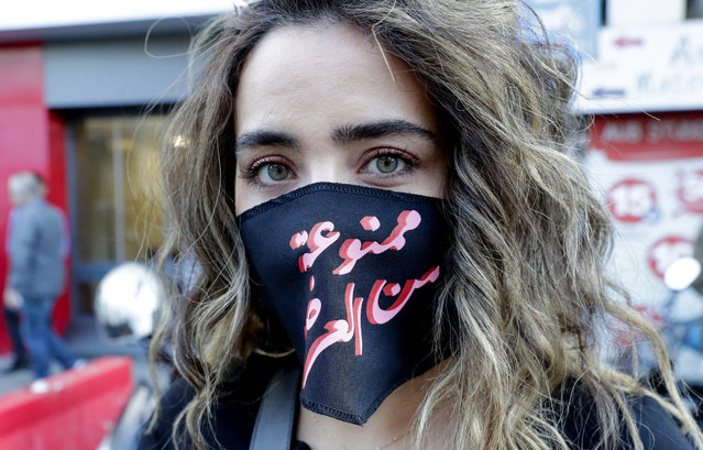 An activist takes part in a demonstration against sexual harassment, rape and domestic violence in the Lebanese capital Beirut on December 7, 2019. (Photo by Anwar Amro/AFP Photo)
