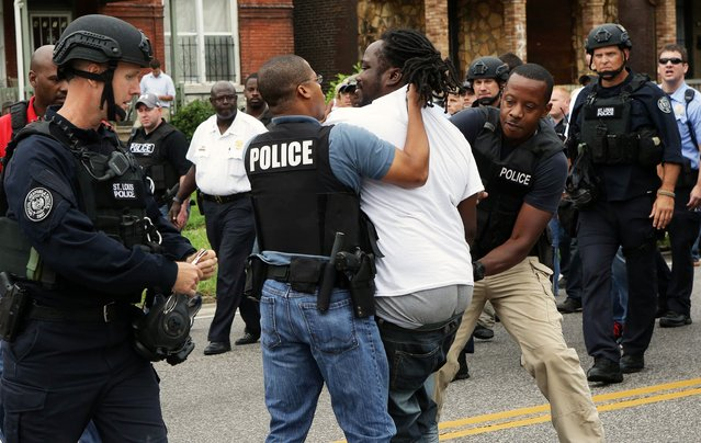 Police arrest a protester that was in the middle of the street after a shooting incident in St. Louis, Missouri August 19, 2015. (Photo by Lawrence Bryant/Reuters)