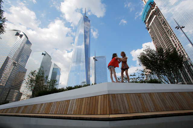 Bella Truman, 9 and Zina DeVoe, 9, both of Manhattan, play in the newly opened Liberty Park above Liberty Street on the World Trade Center site in the Manhattan borough of New York, U.S., June 29, 2016. (Photo by Andrew Kelly/Reuters)