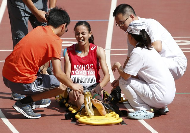 Hanane Ouhaddou of Morocco is placed on a stretcher after the women's 3,000 metres steeplechase heat during the 15th IAAF World Championships at the National Stadium in Beijing, China August 24, 2015. (Photo by David Gray/Reuters)