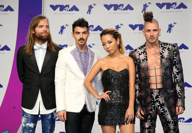 DNCE pose in the press room at the MTV Video Music Awards at The Forum on Sunday, August 27, 2017, in Inglewood, Calif. (Photo by Danny Moloshok/Reuters)
