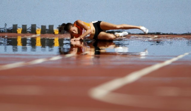 Maureen Koster of the Netherlands falls during the women's 5,000 metres heats during the 15th IAAF World Championships at the National Stadium in Beijing, China August 27, 2015. (Photo by Lucy Nicholson/Reuters)