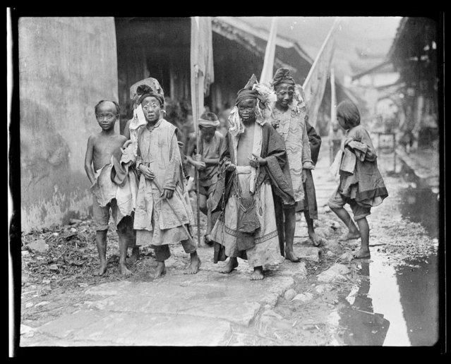 City God, Attendant & Boys. China, An Xian, 1917-1919. (Photo by Sidney David Gamble)