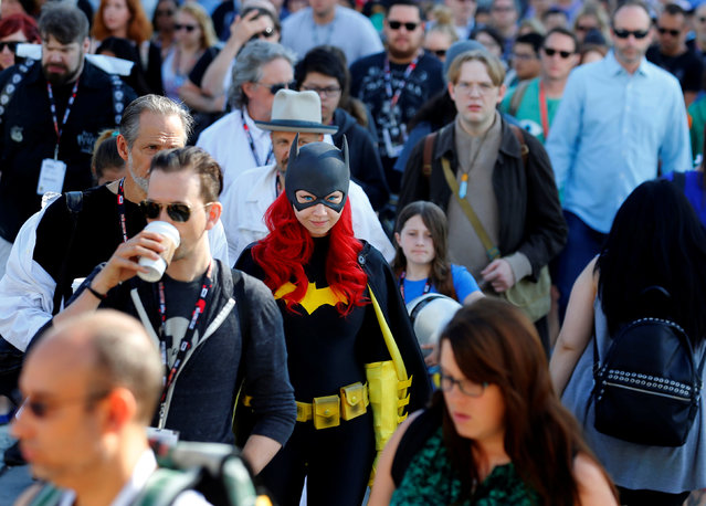 Gina Gianni of Chicago comes dressed as an animated Batgirl as she waits in a crowd to cross the street  to attend the pop culture event Comic-Con International in San Diego, California, United States July 22, 2016. (Photo by Mike Blake/Reuters)
