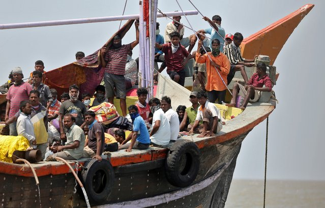 Indian fishermen, who said they were refused entry at two ports after a nationwide lockdown was imposed to fight the coronavirus disease (COVID-19), travel in the Arabian Sea attempting to reach to their home state Maharashtra from the western state of Gujarat, in Dahanu in Palghar district in Maharashtra, India, April 17, 2020. (Photo by Prashant Waydande/Reuters)