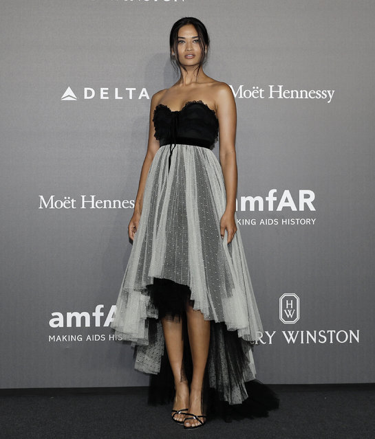 Shanina Shaik poses for photographers as she arrives for the amfAR charity dinner during the fashion week in Milan, Italy, Thursday, September 21, 2017. (Photo by Antonio Calanni/AP Photo)