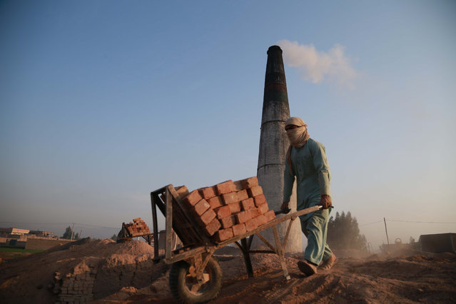 An Afghan laborer works at a brick kiln, in Jalalabad, Afghanistan, 24 February 2020. Afghan President Ghani said on 21 February, said that a seven-day reduction in violence promised by the Taliban will determine the government's next steps in Afghanistan's peace process. The Taliban has announced a decrease in hostilities in an agreement with the United States as a preliminary step to signing a peace deal with Washington on 29 February. (Photo by Ghulamullah Habibi/EPA/EFE)