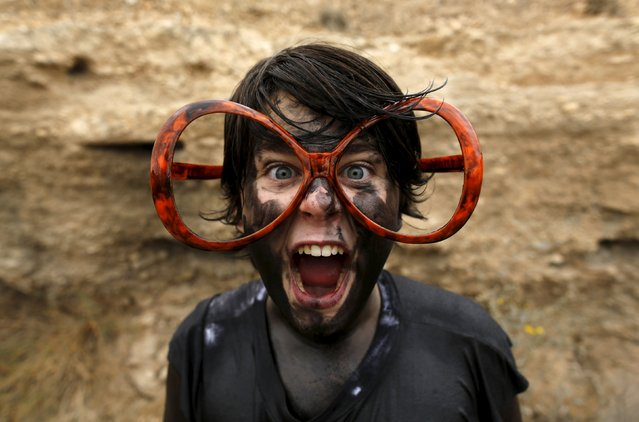 "Jose, a reveller covered in grease, poses for a photo as he takes part in the annual Cascamorras festival in Baza, southern Spain September 6, 2015. The festival was inspired by a dispute between the town of Baza and Guadix over the possession of an icon of the Virgin of Piedad. The Cascamorras refers to representatives from Guadix, who were sent to Baza to recover the statue. As the Cascamorras had to stay perfectly clean to gain possession of the statue, Baza residents attempt to make them as ""dirty"" as possible. (Photo by Marcelo del Pozo/Reuters)"