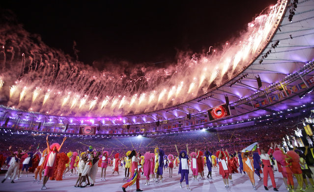Pyrotechnics light up the sky as artists perform during the opening ceremony for the 2016 Summer Olympics in Rio de Janeiro, Brazil, Friday, August 5, 2016. (Photo by Matt Slocum/AP Photo)