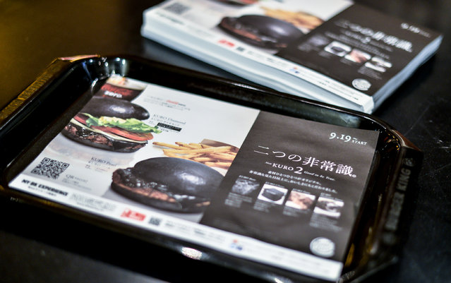 Advertising place mats touting the new black hamburger are seen at a Burger King restaurant on September 18, 2014 in Tokyo, Japan. (Photo by Keith Tsuji/Getty Images)