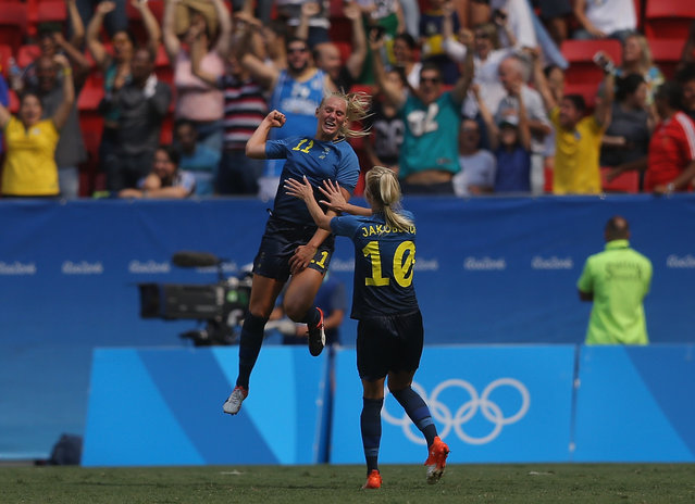 Stina Blackstenius #11 of Sweden celebrates her goal with teammate Sofia Jakobsson #10 in the second half against the United States during the Women's Football Quarterfinal match at Mane Garrincha Stadium on Day 7 of the Rio 2016 Olympic Games on August 12, 2016 in Brasilia, Brazil. (Photo by Celso Junior/Getty Images)