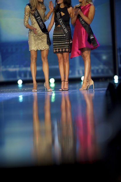 (L-R) Miss Florida Mary Katherine Fechtel, Miss Oklahoma Georgia Frazie, and Miss Texas Shannon Sanderford await the judges decision during the Miss America Pageant at Boardwalk Hall, in Atlantic City, New Jersey, September 13, 2015. (Photo by Mark Makela/Reuters)