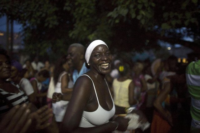 People dance during the party of Yensy Villarreal, 9, (not pictured), in celebration for becoming a Santero after passing a year-long rite of passage in the Afro-Cuban religion Santeria, Havana, July 5, 2015. (Photo by Alexandre Meneghini/Reuters)