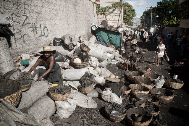 Port-au-Prince, Haiti. Charcoal seller in November 2003. (Photo by Jean-Claude Coutausse)