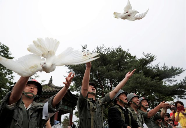 Doves are released during a ceremony commemorating the 70th anniversary of the Korean War, near the demilitarized zone separating the two Koreas, in Cheorwon, South Korea, June 25, 2020. (Photo by Kim Hong-Ji/Reuters)