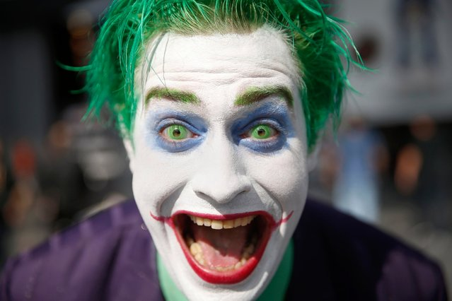 "Trevor Olson, from Minnesota, dressed as the character ""Joker"", poses for a photograph at New York's Comic Con convention, October 9, 2014, in New York City. (Photo by Shannon Stapleton/Reuters)"