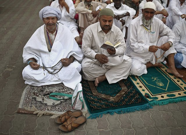 Muslim pilgrims prepare to attend Friday prayers outside the Grand mosque in the holy city of Mecca ahead of the annual haj pilgrimage, September 18, 2015. (Photo by Ahmad Masood/Reuters)