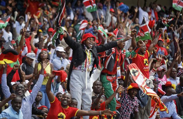 Supporters cheer  in the stands as President Uhuru Kenyatta is sworn-in during his presidential inauguration at Kasarani stadium in Nairobi, Kenya Tuesday, November 28, 2017. (Photo by Ben Curtis/AP Photo)