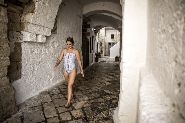 In this handout image provided by Red Bull, Rachelle Simpson of the USA walks back to the platform after diving during the first competition day of the fifth stop of the Red Bull Cliff Diving World Series, Polignano a Mare, Italy on August 28, 2016. (Photo by Dean Treml/Red Bull via Getty Images)