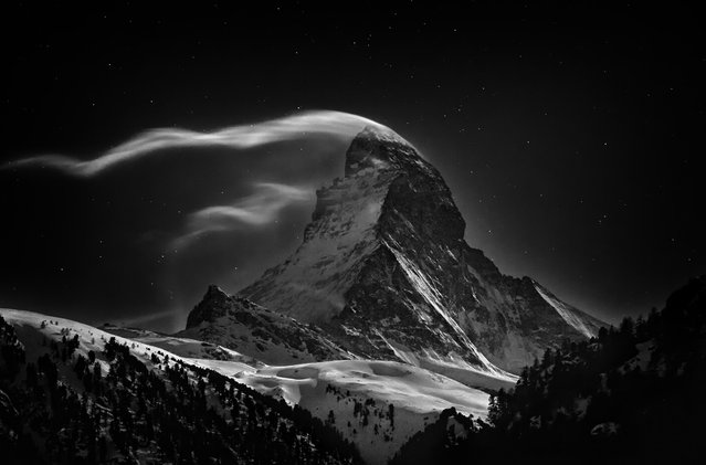 """The Matterhorn: Night Clouds #2 – The Matterhorn, 4478 m, at full moon"". (Photo and comment by Nenad Saljic/National Geographic Photo Contest via The Atlantic)"