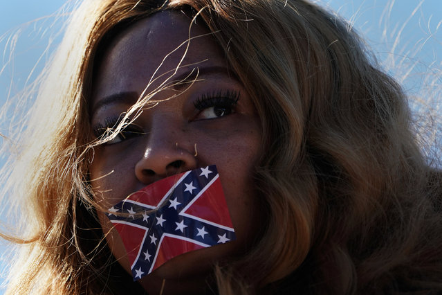 Edelia Carthan stands in silent protest with a confederate flag sticker covering her mouth during the official opening ceremony for the Mississippi Civil Rights Museum in Jackson, Miss., December 9, 2017. (Photo by Carlo Allegri/Reuters)